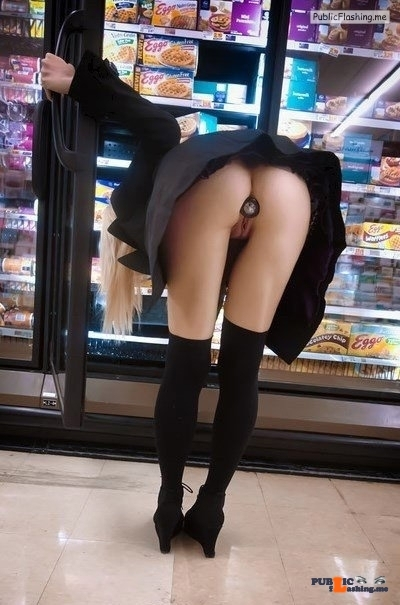 Public flashing photo carelessinpublic: Bending inside a shop in a short dress…
