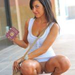 Public flashing photo oramixbottomlessoramix: Proudly showing her passport.