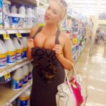 Public flashing photo nudeandnaughtyflashing:Getting her tits out while out grocery…