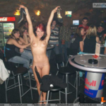 Public nudity photo equus428: She likes getting naked in bars.Once the clothes are…