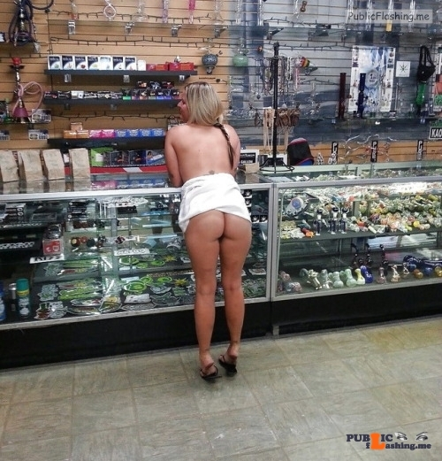 Public flashing photo carelessinpublic:Almost topless inside a shop in a short skirt…