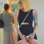 enticing-dress-code:Teasing inked clam flashing in public picture