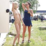 Public nudity photo cfnf-clothed-female-naked-female:Sexy clothed girl with naked…
