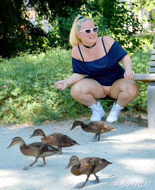 No panties justbuttcat: Feeding ducklings in a park. pantiesless