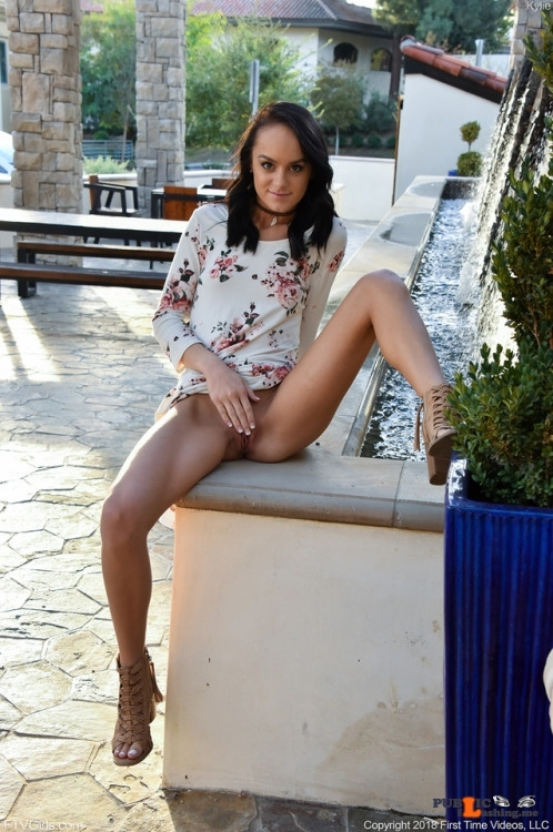 FTV Babes upskirt Little Kylie spreads wide in a public place to show us that she…