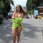 Public nudity photo carelessinpublic: Posing almost topless in a short dress and…